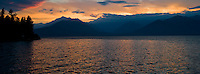 sunset over the Olympic Mountains across the Hood Canal at Big Beef Creek on the Kitsap Peninsula in Puget Sound, Washington, USA