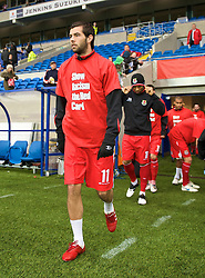 CARDIFF, WALES - Saturday, November 14, 2009: Wales' Joe Ledley runs out wearing a 'Show Racism the Red Card' shirt before the international friendly match against Scotland at the Cardiff City Stadium. (Pic by David Rawcliffe/Propaganda)