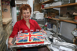 Cambridge, UK  29/04/2011. The Royal Wedding of HRH Prince William to Kate Middleton. Cake made for a street party in Cambridge with Jean Gawlinski holding. Photo credit should read Jason Patel/LNP.