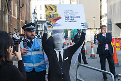 "St James, London, May 12th 2016. Protesters from transparency and accountability group One demonstrate demanding ""a new, global standard of transparency that could end the corruption that keeps people poor"". PICTURED: A protester in a ""morph suit"" outside the conference security cordon."