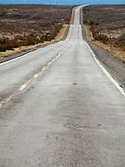 Lonely western Colorado Route 139 traverses vacant rangeland in Garfield County between Douglas Pass and Fruita, Colorado, USA.