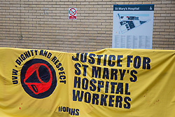 London, UK. 25 November, 2019. A banner used by outsourced workers belonging to the United Voices of the World (UVW) trade union on the picket line outside their workplace at St Mary's Hospital Paddington. Outsourced to Imperial College Healthcare NHS Trust via Sodexo, one of the world's largest multinational corporations, around 200 migrant cleaners, porters and caterers are striking to become NHS employees and have declared an indefinite strike in January 2020. Credit: Mark Kerrison/Alamy Live News