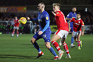 AFC Wimbledon midfielder Dylan Connolly (16) battles for possession with Barnsley midfielder Cameron McGeehan (8) during the EFL Sky Bet League 1 match between AFC Wimbledon and Barnsley at the Cherry Red Records Stadium, Kingston, England on 19 January 2019.
