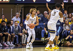 Dec 1, 2019; Morgantown, WV, USA; West Virginia Mountaineers forward Emmitt Matthews Jr. (11) looks to pass during the first half against the Rhode Island Rams at WVU Coliseum. Mandatory Credit: Ben Queen-USA TODAY Sports