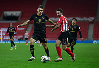 Football - 2020 / 2021 Sky Bet League One - Sunderland vs Milton Keynes Dons - Stadium of Light<br /> <br /> Warren O'Hora of Milton Keynes Dons vies with Will Grigg of Sunderland<br /> <br /> <br /> COLORSPORT/BRUCE WHITE