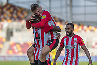 Football - 2020 / 2021 Sky Bet (EFL) Championship - Brentford vs. Huddersfield Town <br /> <br /> Josh Dasilva (Brentford  FC) is congratulated by Sergi Canos (Brentford  FC) after scoring at the Brentford Community Stadium<br /> <br /> COLORSPORT/DANIEL BEARHAM