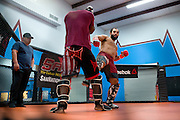 Johny Hendricks throws a leg kick during a sparring session at Velociti Fitness in Pantego, Texas on February 6, 2014.