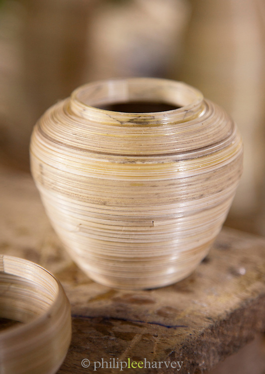 Bamboo strips are wound and create a pot which will later be lacquered and decorated. Seen here at a workshop in Bagan new city, Myanmar