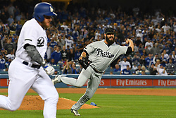 May 28, 2018 - Los Angeles, CA, U.S. - LOS ANGELES, CA - MAY 28: Philadelphia Phillies pitcher Adam Morgan (46) tries to throw to first to get Los Angeles Dodgers infielder Max Muncy (13) during a MLB game between the Philadelphia Phillies and the Los Angeles Dodgers on Memorial Day, May 28, 2018 at Dodger Stadium in Los Angeles, CA. (Photo by Brian Rothmuller/Icon Sportswire) (Credit Image: © Brian Rothmuller/Icon SMI via ZUMA Press)