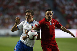 September 10, 2018 - Lisbon, Portugal - Federico Chiesa of Italy and AC Fiorentina (L) vies for the ball with Mario Rui of Portugal and Napoli (R)  during the UEFA Nations League A group football match between Portugal and Italy, in Lisbon, on September 10, 2018. (Credit Image: © Carlos Palma/NurPhoto/ZUMA Press)