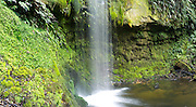 View of Koropuku Falls, a small waterfall off the beaten track, buried within The Catlins Rainforest Reserve, Otago, New Zealand.