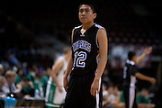 .Navajo Pine Warriors Keithan(CQ) Sandoval (12) looks at the clock at his team trail late during the second half of Wednesday nights game at the Santa Anna Star Center in Rio Rancho NM. Hagerman defeated Navajo Pine 76-61.