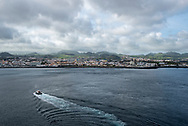 A pilot boat returns to port in Ponta Delgada, Azores, after escorting a cruise ship out to sea. (April 21, 2018)
