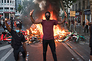 Protester kneeling, with fist salute, with burning barricades of bicycles. Black tuesday commemoration of the deaths of Adama Traore in France and George Floyd in USA. Tribunal de Paris, Paris, June 2, 2020. Photography by Nigel Dickinson/Hans Lucas.<br /> Manifestant a genoux, avec le poing salut, avec des barricades brulantes de velos. Mardi noir commemoration de la mort d Adama Traore en France et de George Floyd aux Etats-Unis. Tribunal de Paris, Paris, 2 juin 2020. Photographie par Nigel Dickinson/Hans Lucas.