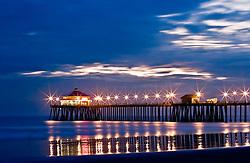 HUNTINGTON BEACH, CA :  Stock photos of the huntington beach pier during sunset. Tel (714) 504-6870. Byline and/or web usage link must read 2007-2012 © Eduardo E. Silva/SILVEX.PHOTOSHELTER.COM.