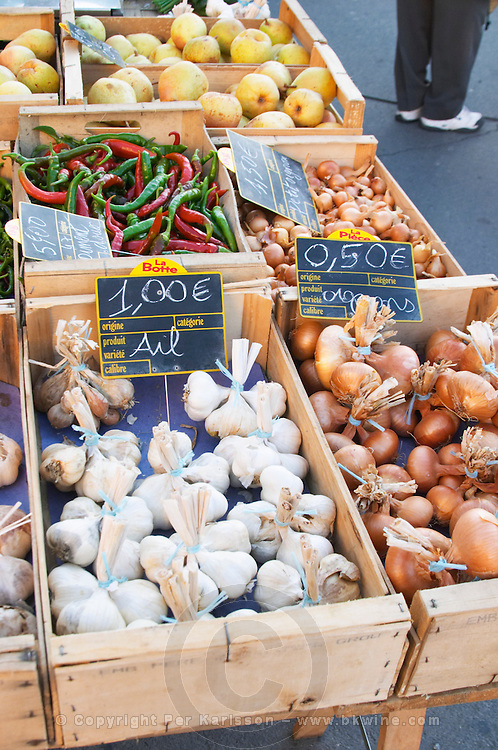 Garlic, onions and pimiento peppers for sale at a market stall at the street market in Bergerac, Bergerac Dordogne France