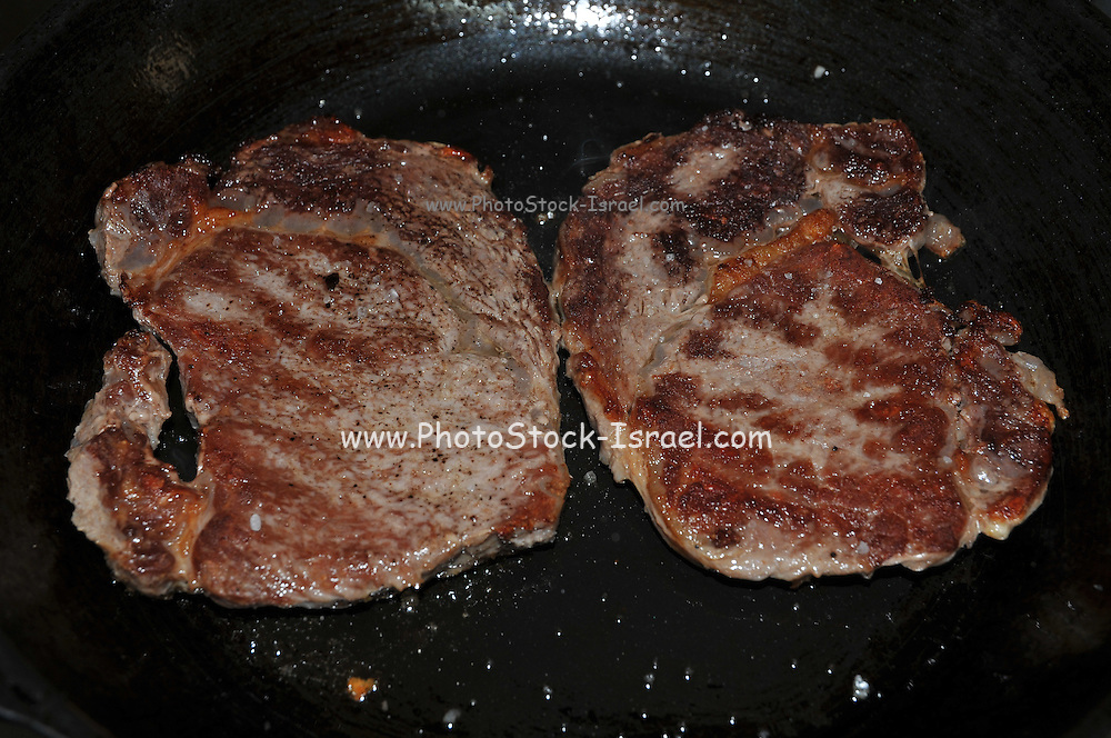beef Steak being grilled