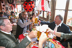 30.09.2015, Theresienwiese, Muenchen, GER, 1. FBL, FC Bayern Muenchen am Oktoberfest, im Bild Josep Guardiola, head coach of FC Bayern Muenchen with his wife Cristina Guardiola, Bayern Muenchen president Karl Hopfner (L) and Bayern Muenchen CEO Karl-Heinz Rummeingge (R) // attend the Oktoberfest beer festival at Kaefer Wiesnschaenke tent at the Theresienwiese in Muenchen, Germany on 2015/09/30. EXPA Pictures © 2015, PhotoCredit: EXPA/ Eibner-Pressefoto/ FCB/POOL<br /> <br /> *****ATTENTION - OUT of GER*****