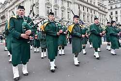 © Licensed to London News Pictures. 18/03/2018. LONDON, UK. A marching band performs. The 16th annual London St. Patrick's Day parade takes place through central London.  Tens of thousands of people enjoy the parade as well as festivities in Trafalgar Square.  The event showcases the best of Irish food, music, song, dance, culture and arts and this year, celebrates the achievements and successes of London's Irish women as part of the Mayor of London's #BehindEveryGreatCity campaign.   Photo credit: Stephen Chung/LNP