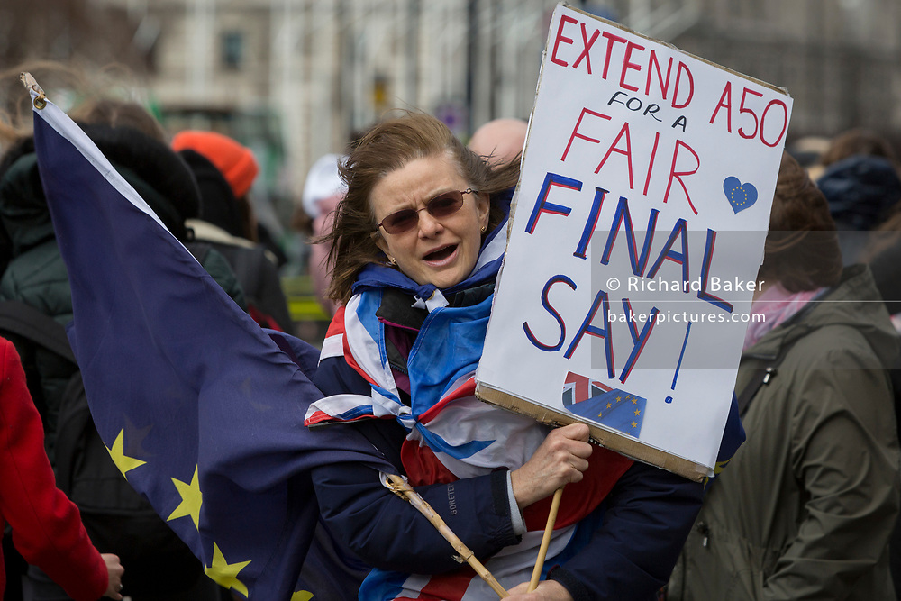 On the day that MPs in Parliament vote on a possible delay on Article 50 on EU Brexit negotiations by Prime Minister Theresa May, a pro-EU activist protests outside the House of Commons, on 14th March 2019, in Westminster, London, England.