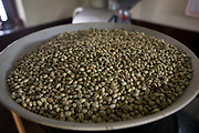 Husked coffee beans being roasted, Ganesh coffee, Madikeri. Coorg or Kadagu is the largest coffee growing region of India, in the state of Karnataka, the inhabitants - the Kodavas have been cultivating crops such as coffee, black pepper and cardamon for many generations.