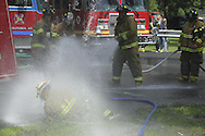 Middletown, NY - Firefighters from surrounding departments hose down Middletown's two new fire trucks during a traditional wetdown at Fancher-Davidge Park on Aug. 23, 2009.