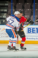 PENTICTON, CANADA - SEPTEMBER 8: Austin Glover #67 of Edmonton Oilers checks a player of the Calgary Flames on September 8, 2017 at the South Okanagan Event Centre in Penticton, British Columbia, Canada.  (Photo by Marissa Baecker/Shoot the Breeze)  *** Local Caption ***