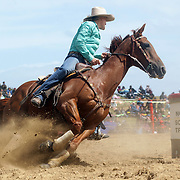 Julie Hogg from Lawrence in action during the Open Barrel Race at the Southland Rodeo, Invercargill,  New Zealand. 29th January 2012