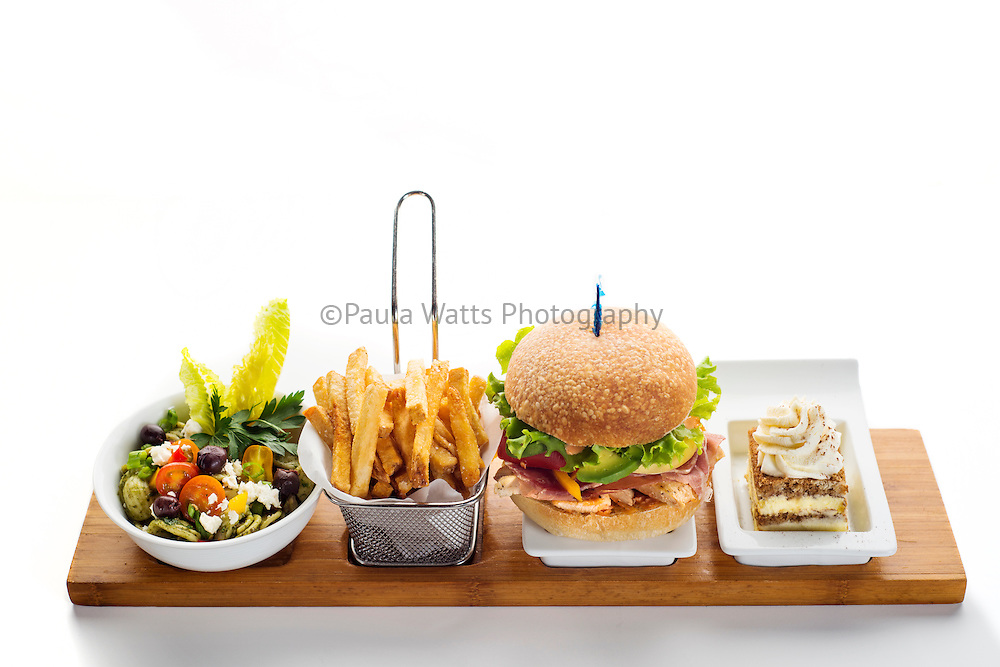 Lunch special with hamburger, french fries, salad and dessert