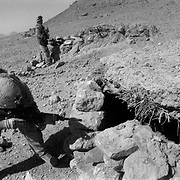 """Alexander The Great invasion route to Kandahar <br /> Sep 10, 2009 - Golestan, Farah Province, Afghanistan - A US Marine from the 2nd MEB of the 2/3 Marines searches holes dug into the ground which appear to be bunker systems during a patrol after sporadic fighting in the village of Gund located in a hostile region between the Black Pass, Buji Bast Pass (aka Bhuji Bast) and """"Fighting Mountain"""" aka """"Kohe Tengay"""" which in Pashto means """"Three Kings""""  in Golestan, Farah Province, where US Marines have been deadlocked in a bitter counterinsurgency campaign and conflict with insurgents using mainly Improvise Explosive Devices (IED's)..(Credit Image: © Louie Palu/ZUMA Press)"""
