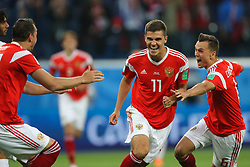 June 19, 2018 - Saint Petersburg, Russia - Roman Zobnin (C), Denis Cheryshev (R) of the Russia national football team celebrates after scoring a goal during the 2018 FIFA World Cup match, first stage - Group A between Russia and Egypt at Saint Petersburg Stadium on June 19, 2018 in St. Petersburg, Russia. (Credit Image: © Igor Russak/NurPhoto via ZUMA Press)