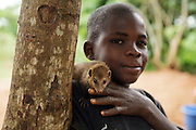"""A boy and his pet """"mangouste"""" in Man, Cote d'Ivoire on Wednesday July 24, 2013."""