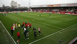Sheffield United players warming up prior to kick-off during the Sky Bet Championship match at Griffin Park, London.