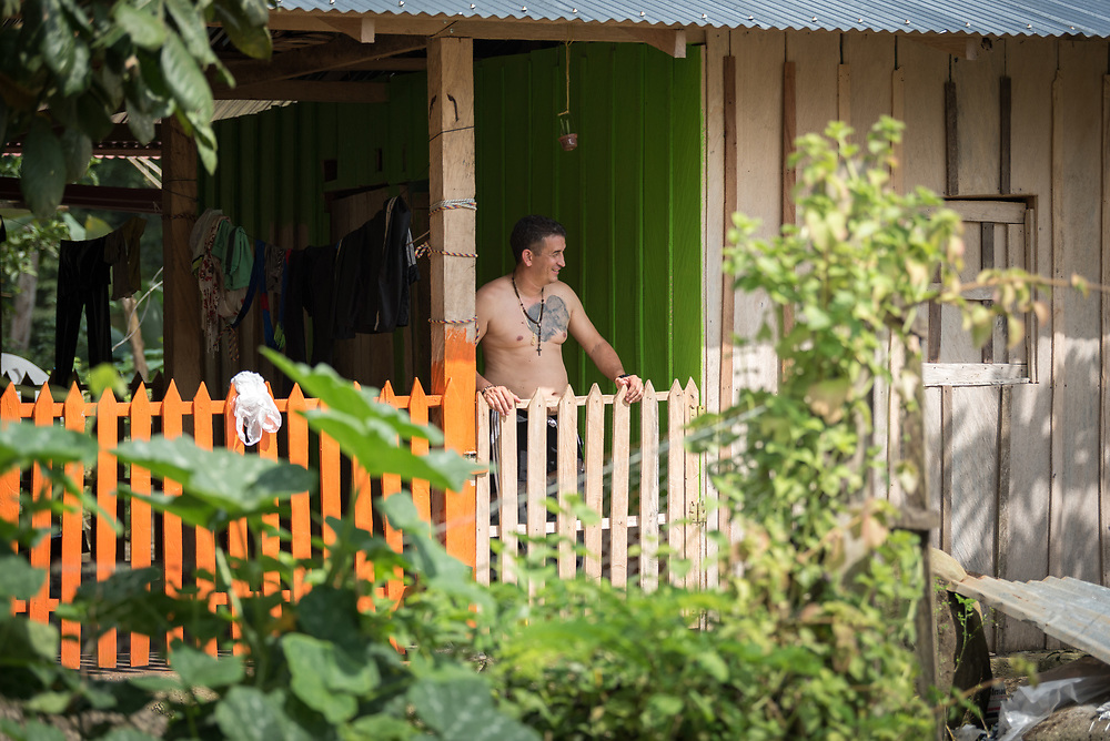 16 November 2018, San José de León, Mutatá, Antioquia, Colombia: Community member Carlos enjoys the view from his porch. Following the 2016 peace treaty between FARC and the Colombian government, a group of ex-combatant families have purchased and now cultivate 36 hectares of land in the territory of San José de León, municipality of Mutatá in Antioquia, Colombia. A group of 27 families first purchased the lot of land in San José de León, moving in from nearby Córdoba to settle alongside the 50-or-so families of farmers already living in the area. Today, 50 ex-combatant families live in the emerging community, which hosts a small restaurant, various committees for community organization and development, and which cultivates the land through agriculture, poultry and fish farming. Though the community has come a long way, many challenges remain on the way towards peace and reconciliation. The two-year-old community, which does not yet have a name of its own, is located in the territory of San José de León in Urabá, northwest Colombia, a strategically important corridor for trade into Central America, with resulting drug trafficking and arms trade still keeping armed groups active in the area. Many ex-combatants face trauma and insecurity, and a lack of fulfilment by the Colombian government in transition of land ownership to FARC members makes the situation delicate. Through the project De la Guerra a la Paz ('From War to Peace'), the Evangelical Lutheran Church of Colombia accompanies three communities in the Antioquia region, offering support both to ex-combatants and to the communities they now live alongside, as they reintegrate into society. Supporting a total of more than 300 families, the project seeks to alleviate the risk of re-victimization, or relapse into violent conflict.