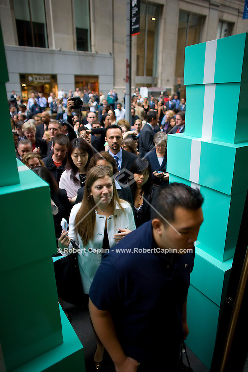 Press and patrons walk into the new Wall Street location after the ribbon cutting Oct. 10, 2007 the day Tiffany & Co. went public and for the ribbon cutting of their new Wall Street store in New York.