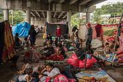 People affected by the floods caused by hurricane Iota, get shelter under a bridge in the west of San Pedro Sula. Many of them arrived there since the two weeks before because they were previously impacted by hurricane Eta from Chamalecón neighborhood.<br /> <br /> November 18, 2020. San Pedro Sula, Cortéz, Honduras.