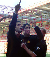 Ruud Van Nistelrooy (Man Utd) celebrates his 1st goal with  Ronaldo (right). Charlton Athletic v Manchester United. 13/9/2003. Credit : Colorsport/Andrew Cowie.