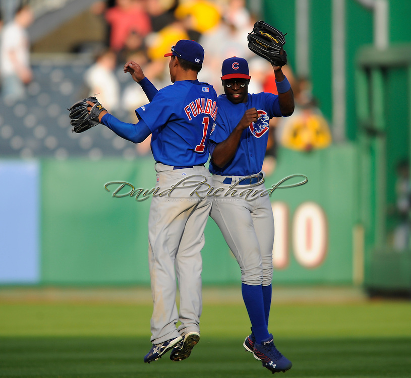 Chicago Cubs left fielder Alfonso Soriano, right, and Kosuke Fukudome..The Chicago Cubs defeated the Pittsburgh Pirates 10-8 in 12 inning on April 7, 2008 at PNC Park on Opening Day. Chicago held an early 7-run lead, only to watch the Pirates come back to force extra frames.