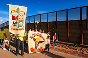 17 APRIL 2005 - NACO, AZ: Progressive Christians on the US side of the US/Mexico border march along the border fence in Naco, AZ to support migrants' rights. The Christians had gathered to protest the presence of the  Minuteman Project in Naco. The Minuteman volunteers were hunting migrants who crossed the border outside of Naco.      PHOTO BY JACK KURTZ