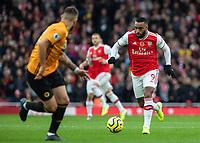 Football - 2019 / 2020 Premier League - Arsenal vs. Wolverhampton Wanderers<br /> <br /> Alexandre Lacazette (Arsenal FC) charges towards the Wolves goal at The Emirates Stadium.<br /> <br /> COLORSPORT/DANIEL BEARHAM