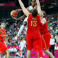 08 August 2012: France Mickael Gelabale goes for the layup against Marc and Pau Gasol during 66-59 Team Spain victory over Team France, during the men's basketball quarter-finals, at the 02 Arena, in London, Great Britain.