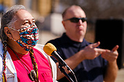 09 MARCH 2021 - DES MOINES, IOWA: RALPH MOISA, a member of the Yaqui tribe, recites an indigenous blessing during a memorial service for the 5,574 Iowans killed by COVID-19 in the one year since the pandemic started. The first three cases of the Coronavirus (SARS-CoV-2), all Iowans who had traveled to Egypt on a cruise, were reported to the Iowa Department of Public Health on March 8, 2020. The first fatality in Iowa was reported on March 25, 2020.      PHOTO BY JACK KURTZ