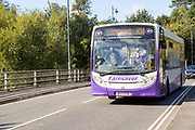 Single decker Faresaver service bus to driver passengers wearing masks, Wiltshire, England, UK, September 2020