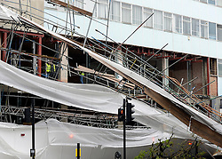 © Licensed to London News Pictures. 29/04/2012. London, UK .  Workmen at the scene. Heavy winds have caused a large section of scaffolding to collapse on building work being carried out for a new Jamie Oliver restaurant on Notting Hill Gate in West London today 29th April 2012. The structure came down at approx 0300am across a main road junction and nobody was hurt. The  Photo credit : Stephen Simpson/LNP