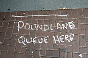 Social distancing sign painted on the floor outside Poundland on 6th June 2020 in Birmingham, United Kingdom. Coronavirus or Covid-19 is a new respiratory illness that has not previously been seen in humans. While much or Europe has been placed into lockdown, the UK government has put in place more stringent rules as part of their long term strategy, and in particular social distancing.