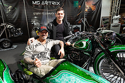 Ms Artrix's Massimo Gullone with friend and customer Italian Olympic fencer Aldo Montano at Motor Bike Expo (MBE) bike show. Verona, Italy. Sunday, January 19, 2020. Photography ©2020 Michael Lichter.