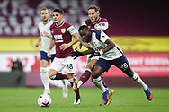 Burnley midfielder Josh Brownhill (8) and Tottenham Hotspur midfielder Tanguy NDombèlé (28) battle for possession  during the Premier League match between Burnley and Tottenham Hotspur at Turf Moor, Burnley, England on 26 October 2020.