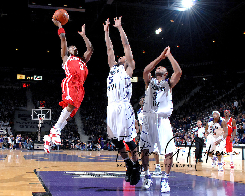 Nebraska guard Charles Richardson Jr. (3) drives and scores over Kansas State defenders Clent Stewart (5) and Lance Harris (3), during the first half at Bramlage Coliseum in Manhattan, Kansas, January 27, 2007.  The Wildcats lead the Huskers at halftime 27-20.