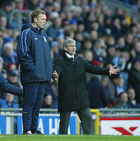 18/12/2004 - FA Barclays Premiership - Blackburn Rovers v Everton - Ewood Park<br />Everton manager David Moyes stands on the touchline in front of Blackburn Rovers' manager Mark Hughes who remonstrates in the background.<br />Photo:Jed Leicester/Back Page Images