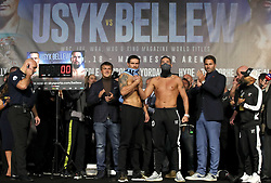 Oleksandr Usyk (left), Tony Bellew (centre) and Promoter Eddie Hearn (right) during the weigh in at Manchester Central.